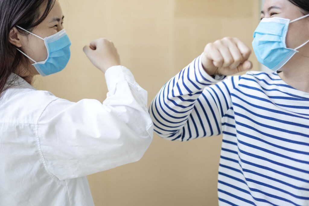 Saying hi to friends without touching hands during coronavirus pandemic